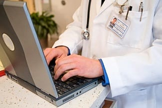 Doctor with Electronic Health Records