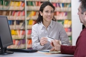 medical assistant collecting payment
