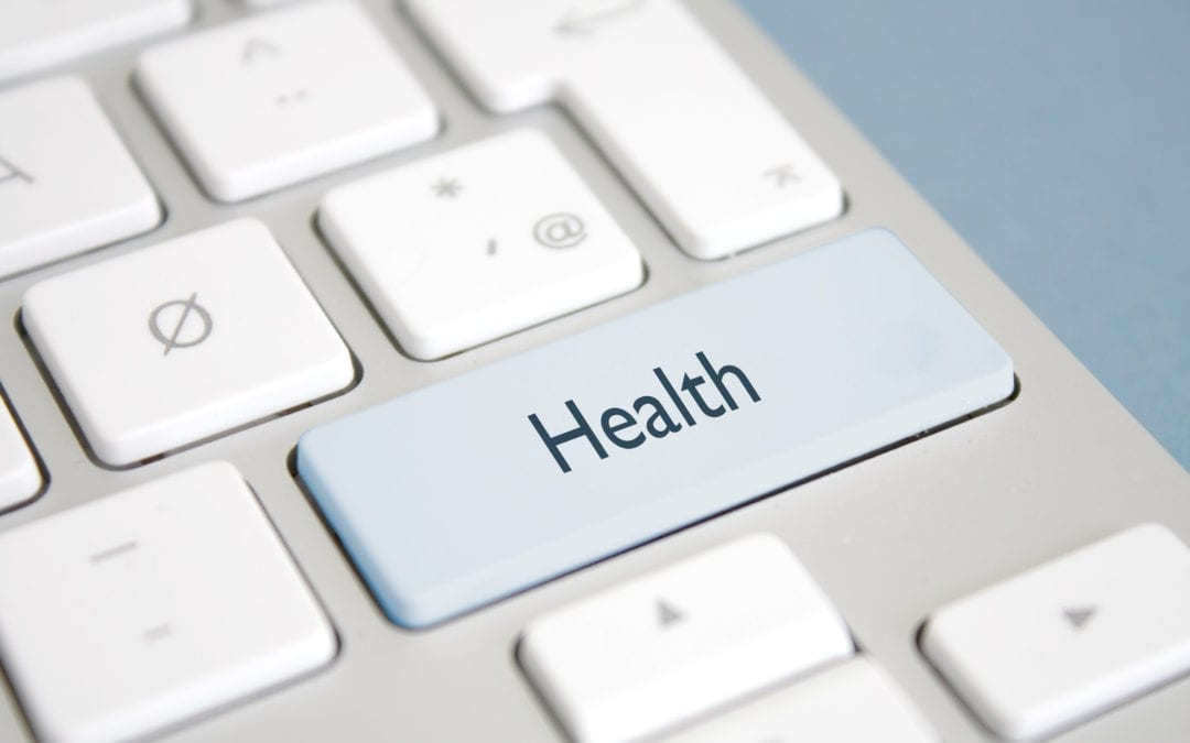 "Computer keyboard with the word ""HEALTH"" where the shift key would normally be."